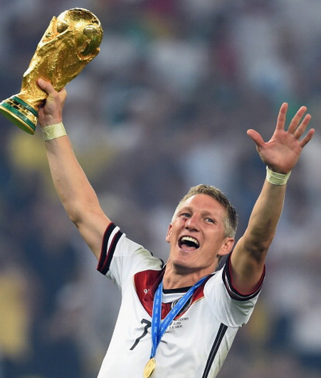 Schweinsteiger with the famous World Cup trophy.