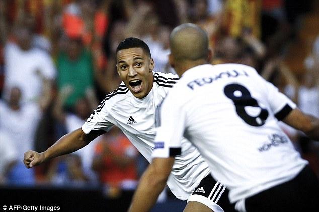 Rodrigo celebrating his goal with fellow goalscorer Sofiane Feghouli. (Daily Mail)