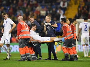Michael Carrick is carried off by stretcher