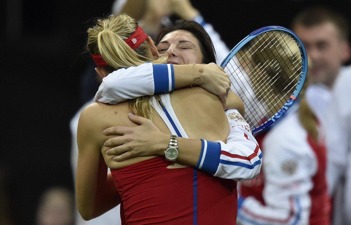 Maria Sharapova and Anastasia Myskina embrace after Sharapova's win (Source: Fed Cup)