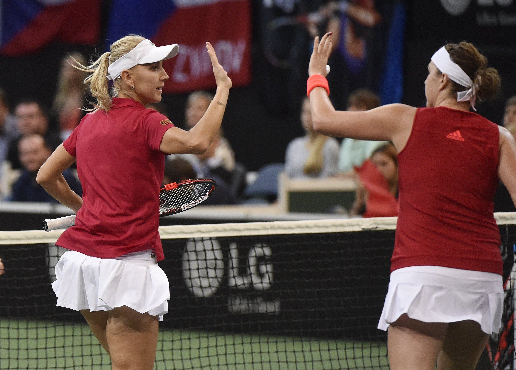 Elena Vesnina and Anastasia Pavlyuchenkova celebrate their opening set win (Source: Fed Cup)
