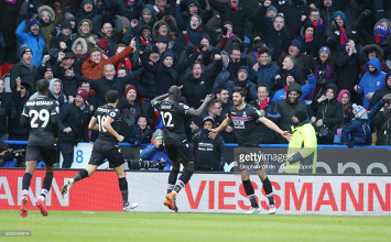 Huddersfield Town 0-2 Crystal Palace: Tomkins and Milivojevic lift Eagles out of relegation zone