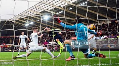 Swansea City 0-4 Arsenal: Gunners comfortable as Swans slipto bottom of the league