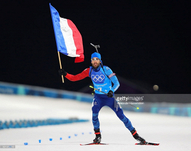 PyeongChang day 11 round-up: Fourcade lands third gold, spearheading France to mixed relay triumph