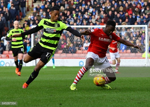 Huddersfield Town target Andy Yiadom left out of Barnsley squad until future decided