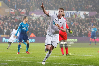 Swansea City 3-1 Arsenal: Swans stun woeful visitors to climb out of drop zone