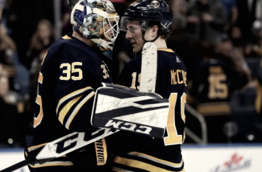 Linus Ullmark hugs Jake McCabe after his impressive win over the Columbus Blue Jackets (USA Today Sports/Kevin Hoffman)