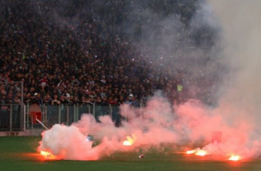 Flares lie pitch side at the Stadio Olimpico