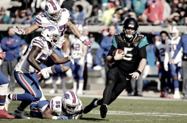 Quarterback Blake Bortles runs away from the Buffalo defense which he did a lot of today. (AP Photo/Mark Zaleski)