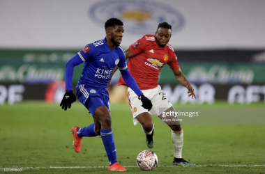 LEICESTER, ENGLAND - MARCH 21: Kelechi Iheanacho of Leicester City in action with Aaron Wan-Bissaka of Manchester United during the Emirates FA Cup Quarter Final match between Leicester City and Manchester United at The King Power Stadium on March 21, 2021 in Leicester, England. Sporting stadiums around the UK remain under strict restrictions due to the Coronavirus Pandemic as Government social distancing laws prohibit fans inside venues resulting in games being played behind closed doors. (Photo by Marc Atkins/Getty Images)