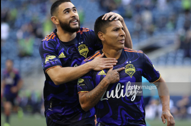 Raul Ruidiaz #9 of Seattle Sounders (R) celebrates with Alex Roldan #16 after scoring a goal to take a 1-0 lead against Los Angeles Galaxy in the first half at Lumen Field on May 02, 2021 in Seattle, Washington. (Photo by Abbie Parr/Getty Images)