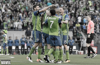 The Sounders celebrate after Chad Marshall's first half goal   Brandon Farris - VAVEL USA