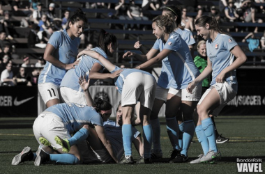 Sky Blue players surround Kelly Conhenny after she scored the game winning goal in the 68th minute / Brandon Farris - VAVEL USA