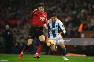 Florin Andone in action against Manchester United. Photo - Getty Images/Gareth Copley