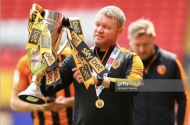 Above: Hull City manager Grant McCann proudly holds the Sky Bet League One trophy, as the Tigers clinch the title (Source: Jacques Feeney, Getty Images)