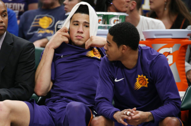 Phoenix Suns guard Devin Booker (1) talks with guard Tyler Ulis (8) on the bench during a game against the Indiana Pacers. |Brian Spurlock-USA TODAY Sports|