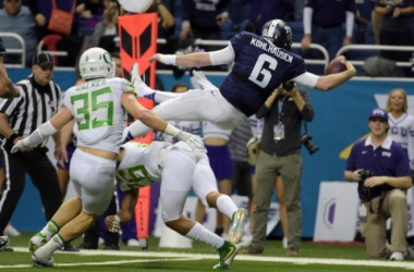 TCU QB Bram Kohlhausen extends the ball after being tackled. Photo via USA TODAY Sports.