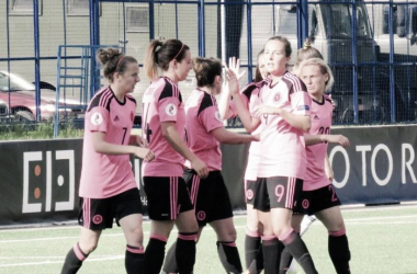 Scotland celebrate Jo Love's lone goal. (Photo: SFA)