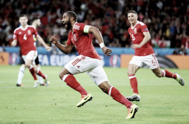 Ashley Williams wheels away in celebration after equalising for Wales against Belgium. (Photo: UEFA)