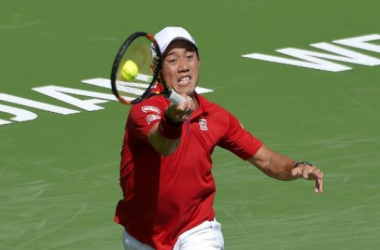 Kei Nishikori, of Japan, returns a hit from Mikhail Kukushkin, duringtheir match at the BNP Paribas Open tennis tournament, Sunday, March 13,2016, in Indian Wells, Calif. (AP Photo/Mark J. Terrill)