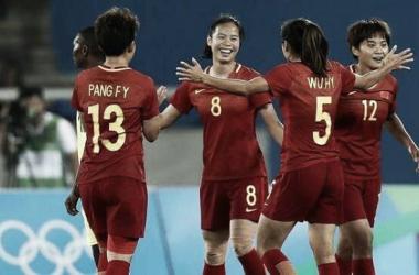Tan Ruyin celebrates with her teammates   Source: fifa.com