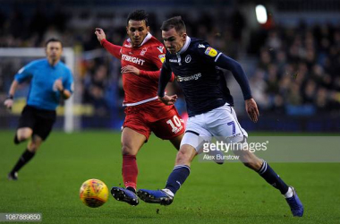 LONDON, ENGLAND - DECEMBER 29: Jed Wallace of Millwall passes the ball under pressure from Joao Carvalho of Nottingham Forest during the Sky Bet Championship match between Millwall and Nottingham Forest at The Den on December 29, 2018 in London, England. (Photo by Alex Burstow/Getty Images)