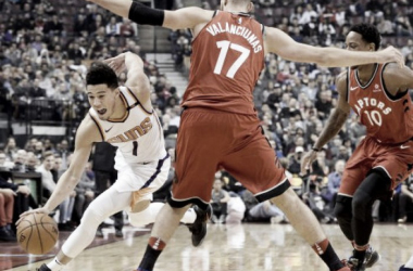 Phoenix Suns guard Devin Booker (1) moves the ball around Toronto Raptors' Joan Valanciunas during the first half of an NBA basketball game Tuesday, Dec. 5, 2017, in Toronto. |Nathan Denette/The Canadian Press via AP|