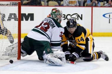 Chris Kunitz beats Niklas Backstrom during the Penguins' 7-2 win against the Minnesota Wild(Photo credit Gene J. Puskar, Associated Press)