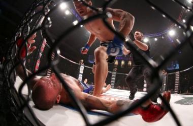 Hisaki Kato stands over Joe Schilling after his devastating KO at Bellator 139 (D. Mandel/Sherdog.com)
