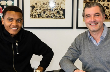Manuel Akanji with Michael Zorc. | Photo: Borussia Dortmund.