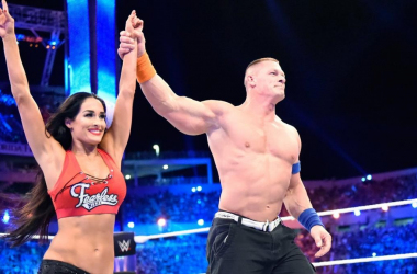 John Cena and Nikki Bella share a Wrestlemania moment together after defeating The Miz and Maryse.  Photo credit: wwe.com