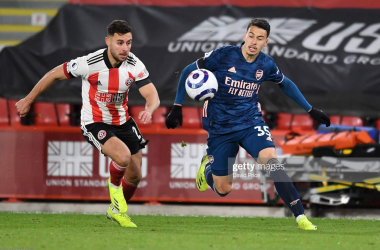 <div>Sheffield United v Arsenal - Premier League</div><div><br></div><div>SHEFFIELD, ENGLAND - APRIL 11: Gabriel Martinelli of Arsenal takes on George Baldock of Sheffield United during the Premier League match between Sheffield United and Arsenal at Bramall Lane on April 11, 2021 in Sheffield, England. (Photo by David Price/Arsenal FC via Getty Images)</div>