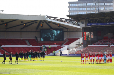 <div>Nottingham Forest v Huddersfield Town - Sky Bet Championship</div><div><br></div><div>NOTTINGHAM, ENGLAND - APRIL 17: Players and Officials observe two minutes of silence prior to kick off in memory of Prince Philip, Duke of Edinburgh during the Sky Bet Championship match between Nottingham Forest and Huddersfield Town at City Ground on April 17, 2021 in Nottingham, England. Sporting stadiums around the UK remain under strict restrictions due to the Coronavirus Pandemic as Government social distancing laws prohibit fans inside venues resulting in games being played behind closed doors. (Photo by Matthew Lewis/Getty Images)</div>