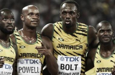 Le relais Jamaïcain (de gauche à droite : Ashmeade, Powell, Bolt et Carter) champion du monde [OLIVIER MORIN / AFP]