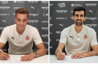 <div>Los dos últimos fichajes del mercado de verano, firmando el contrato. Foto realizada por el Girona FC</div>