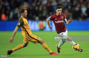 Dale Stephens and Aaron Cresswell fight for the ball. Photo - Getty Images