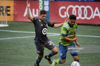 SEATTLE, WA - APRIL 16: Minnesota United FC midfielder Wil Trapp (20) defends against Seattle Sounders FC midfielder Cristian Roldan (7) during a MLS match between the Seattle Sounders and Minnesota United FC on April, 16, 2021 at Lumen Field in Seattle, WA (Photo by Jeff Halstead/Icon Sportswire via Getty Images)