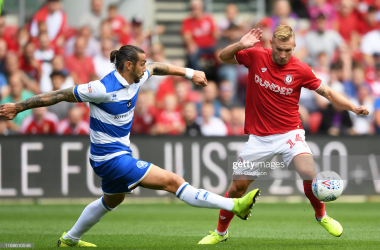 BRISTOL, ENGLAND - AUGUST 17: Andreas Weimann (r) of Bristol City competes with Geoff Cameron of Queens Park Rangers during the Sky Bet Championship match between Bristol City and Queens Park Rangers at Ashton Gate on August 17, 2019 in Bristol, England. (Photo by Alex Davidson/Getty Images)