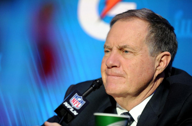 Bill Belichick talking to the press on opening night (Photo: Getty Images)