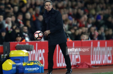 Claude Puel, Manager of Southampton catches the ball