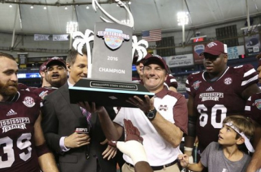 Mississippi State head coach Dan Muleln hold up the St. Petersburg Bowl trophy the Bulldogs escaped with a one-point win over Miami-Ohio/Photo; Chris O'Meara/Associated Press