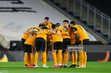 WOLVERHAMPTON, ENGLAND - APRIL 05: Players of Wolverhampton Wanderers huddle prior to the Premier League match between Wolverhampton Wanderers and West Ham United at Molineux on April 05, 2021 in Wolverhampton, England. Sporting stadiums around the UK remain under strict restrictions due to the Coronavirus Pandemic as Government social distancing laws prohibit fans inside venues resulting in games being played behind closed doors. (Photo by Sam Bagnall - WWFC/Wolves via Getty Images)