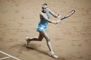 Mladenovic (pictured) advances as Konjuh retires after two sets