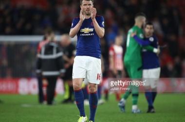 Michael Carrick applauding fans after the Premier League game against Southampton. | Photo: Julian Finney