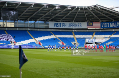 Both sets of players observe a two minutes silence prior to the EFL Championship fixture between Cardiff City and Blackburn Rovers | Photo by Cardiff City FC/Getty Images