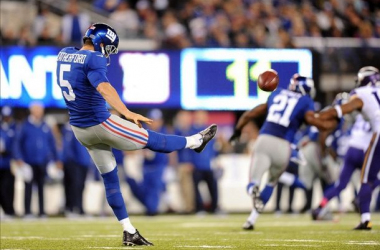 Giants Punter Steve Weatherford boots a ball away against the Minnesota Vikings. Photo courtesy of Joe Camporeale.