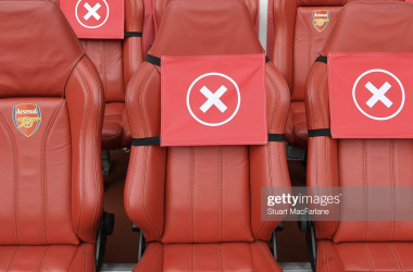 LONDON, ENGLAND - MAY 23: Social distance markings on the Arsenal bench before the Premier League match between Arsenal and Brighton & Hove Albion at Emirates Stadium on May 23, 2021 in London, England. A limited number of fans will be allowed into Premier League stadiums as Coronavirus restrictions begin to ease in the UK following the COVID-19 pandemic. (Photo by Stuart MacFarlane/Arsenal FC via Getty Images)