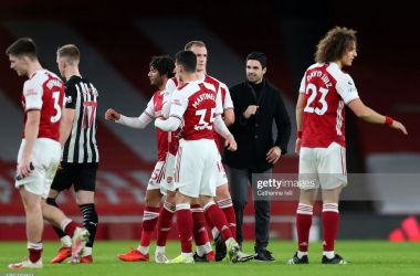 <div>Arsenal v Newcastle United - Premier League</div><div><br></div><div>LONDON, ENGLAND - JANUARY 18: Mikel Arteta, Manager of Arsenal celebrate with Mohamed Elneny, Rob Holding, Gabriel Martinelli and David Luiz of Arsenal following their side's victory in during the Premier League match between Arsenal and Newcastle United at Emirates Stadium on January 18, 2021 in London, England. Sporting stadiums around England remain under strict restrictions due to the Coronavirus Pandemic as Government social distancing laws prohibit fans inside venues resulting in games being played behind closed doors. (Photo by Catherine Ivill/Getty Images)</div>