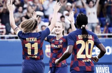 Alexia Putellas, Asisat Oshoala y Caroline Graham celebrando un gol en la máxima competición continental durante la presente temporada | Foto de Noelia Déniz, VAVEL
