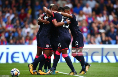Huddersfield players celebrate their opening Premier League goal